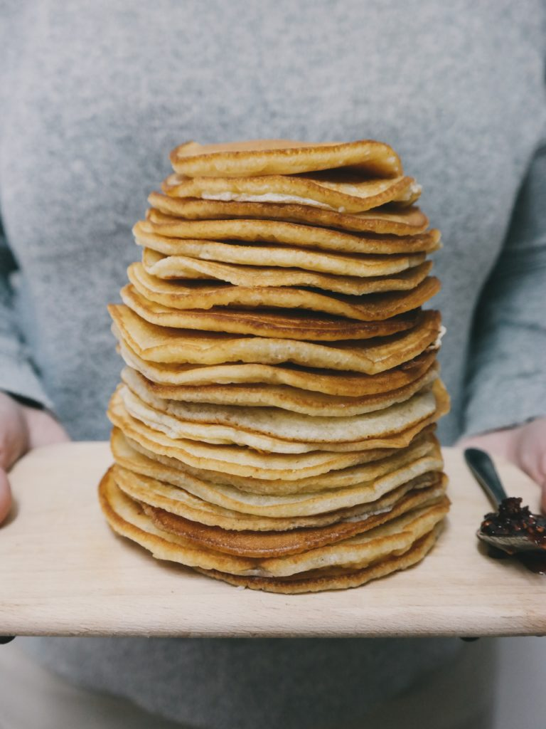 Stacked Pancakes Carried on Plate